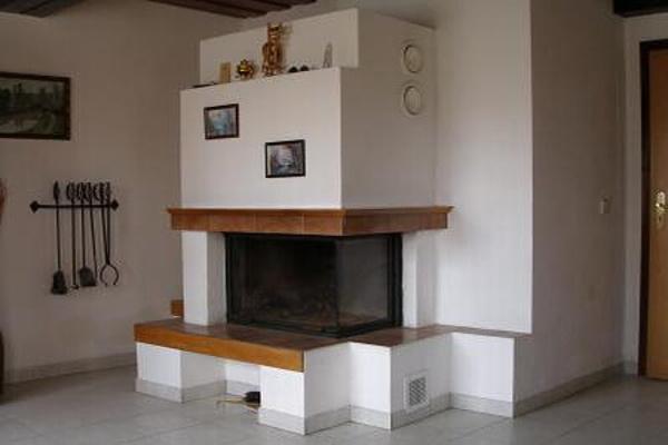 Chaty a chalupy k pronajmutí - Chalupa v Odranci - obývací pokoj s krbem